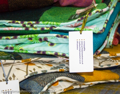 Luxurious quilts by Lisa Watson. Do you recognise the fabric used in one? ;)